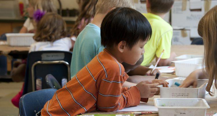 Asian boy learning at school