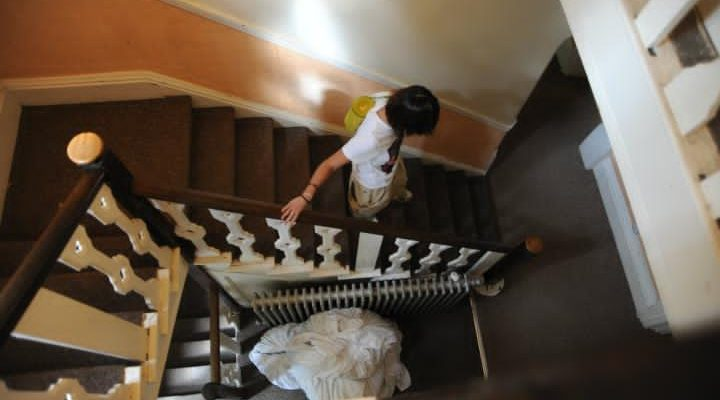 Girl climbing down the stairs