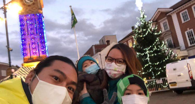 Family of four enjoying Christmas